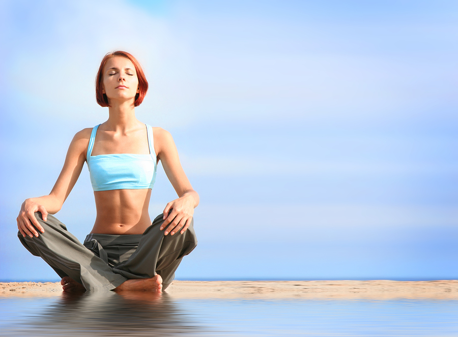 bigstock-young-girl-meditating-on-beach-16926665