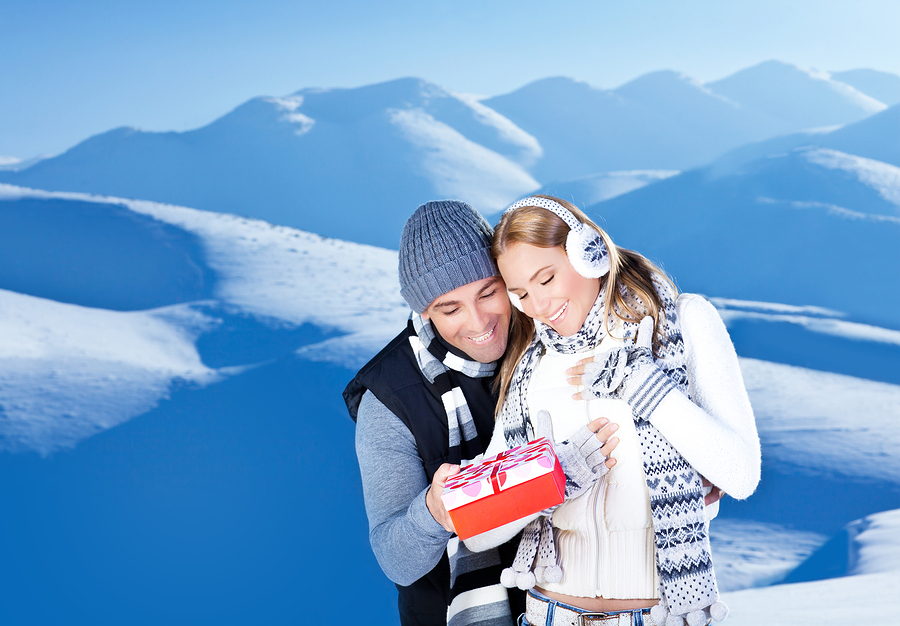 Happy couple outdoor at winter mountains