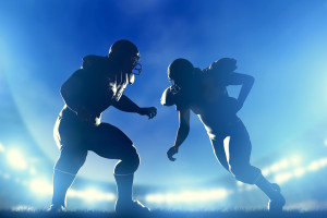 American football players in game, quarterback running. Night st