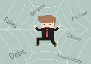 Businessman Stuck On Spider Web